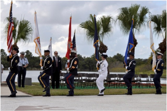 The Joint Service Color Guard, made up of students and faculty from the Defense Equal Opportunity Management Institute, prepare to post the colors during the Massing of the Colors in the amphitheatre of the Brevard Community College, Cocoa, Fla., Nov. 11, 2012.