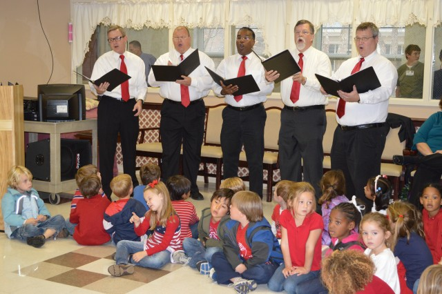 "The SMDC Missile Tones, a quintet to include (from left) Robin Stuart, Willie Ransom, Leonard Adams, David Crouch and Reed Carpenter sing Patriotic songs during a Veterans Day Ceremony at Floyd E. ""Tut"" Fann State Veterans Home in Huntsville, Ala., Nov. 12."