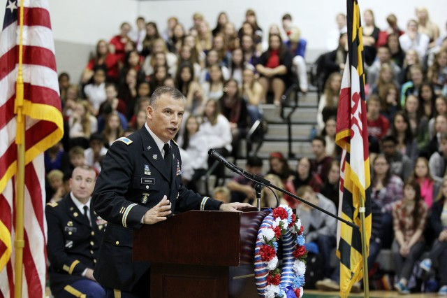 Garrison Commander Col. Edward C. Rothstein addresses Century High School in Sykesville during its Veterans Day Assembly on Friday. The 90-minute event also featured the school's chorus and wind ensemble, the Coast Guard Academy Glee Club, a gold star mother and various displays.