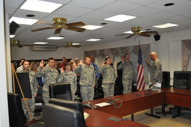 Personnel from the U.S. Army Evaluation Center reaffirm their oaths in a ceremony earlier this fall as part of the U.S. Army Test and Evaluation Command's Operation Solemn Promise campaign.