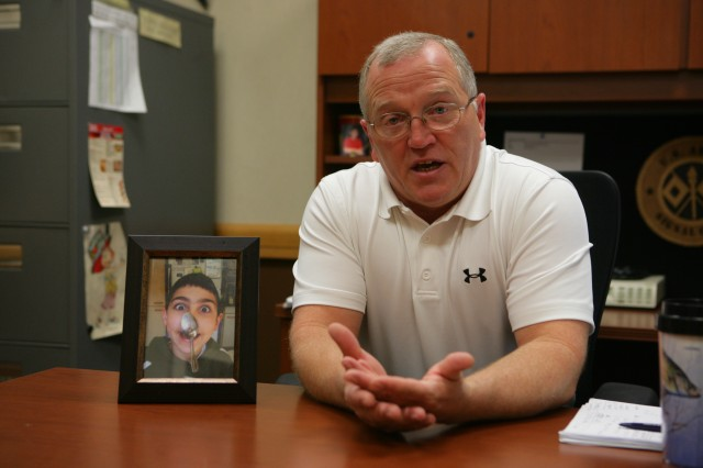 David Rauls, a suicide survivor, talks about overcoming his grief at Fort Sill. The photo beside him is his son, Nicholas hamming it up for the camera a few years ago. Rauls, his wife, Michelle and their son Jacob, became survivors of suicide when Nicholas, age 13, took his life in February, 2010.