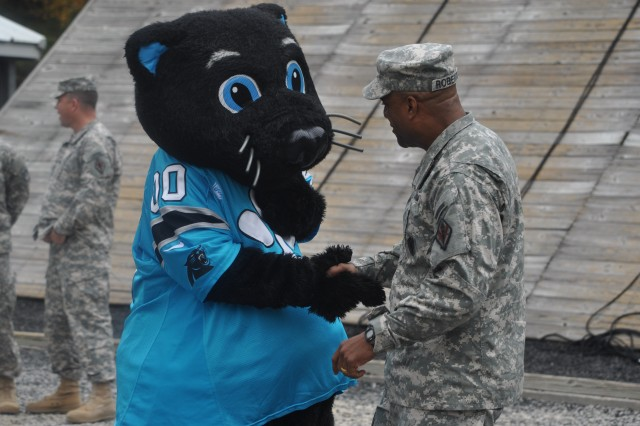 Brig. Gen. Bryan Roberts, Fort Jackson's commanding general, greets Sir Purr, the Panthers' mascot, before Sir Purr takes on Victory Tower.