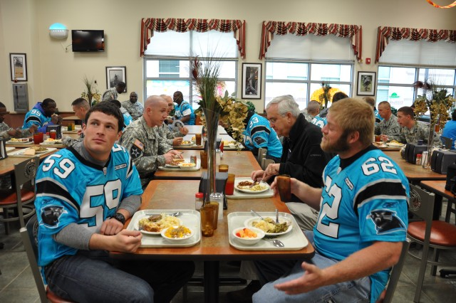 Members of the team enjoy lunch with Soldiers at the Drill Sergeant School dining facility.