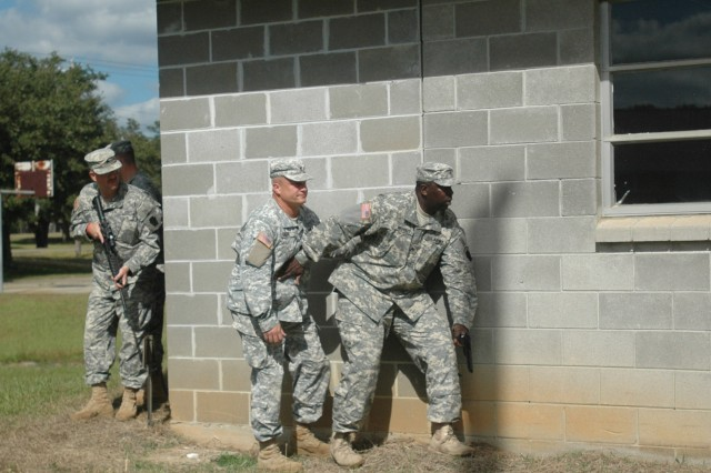 Members on the unit ministry team, 55th Brigade Combat Team, a Pennsylvania National Guard, moving thru hostile environment during pre deployment training held at Camp Shelby Joint Force Training Center, Miss.