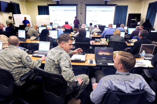 More than 40 representatives from various agencies gather at the JBLM Headquarters building for the installation's second virtual town hall meeting of the year.