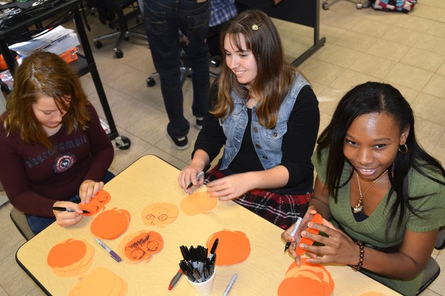 Vicenza High School students create Halloween decorations for a Future Business Leaders of America fundraiser in the school's computer lab Oct. 18, 2012. All are aware of cyberbullying, though none have experienced it personally. Educators at DoDDS-Europe schools in Vicenza, Italy, are reaching out to parents to create effective, nonpunitive approaches to protecting middle and high school students from the adverse effects of online bullying.
