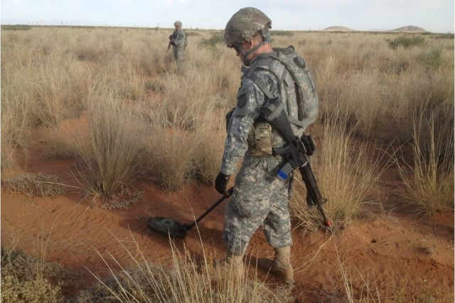 "A Soldier with the Army Reserve's 402nd Engineer Company out of Des Moines, Iowa, sweeps for buried improvised explosive devices during route clearance training conducted by 1st Battalion, 361st Engineer Regiment, ""Redhawk,"" 5th Armored Brigade, Division West, at McGregor Range, N.M., Nov. 3. The 402nd Soldiers are training with Division West before deploying to Afghanistan. (Photo by Staff Sgt. Brendon Domingo, 1st Battalion, 361st Engineer Regiment, 5th Armored Brigade, Division West)"