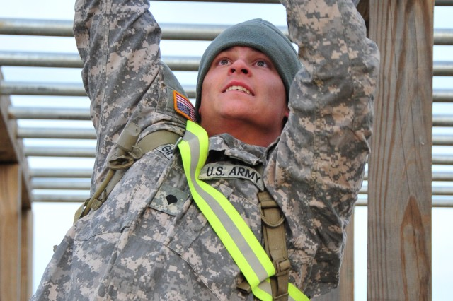 Soldiers from the 4th Brigade Combat Team, 101st Airborne Division, compete in the brigade's top squad competition on November 14, 2012 at Fort Campbell, Ky. The competition's events included a 1/2-mile run with a 30-foot log, 1/4-mile stretcher carry, obstacle course, buddy team carry, and call-for-fire scenario. Each battalion from within the brigade sends one squad each month to compete for the honor and bragging rights of being named the 'Top Squad'.