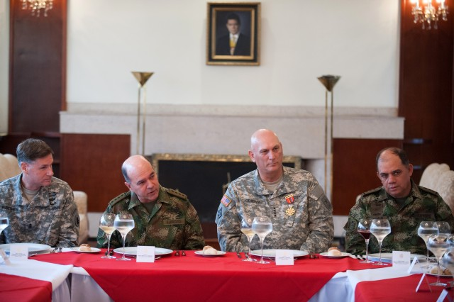 From left, U.S. Army Maj. Gen. Frederick S. Rudesheim, Commander of Army South, Colombian Army Chief of Staff Gen. Sergio Mantilla Sanmiguel, U.S. Army Chief of Staff Gen. Raymond T. Odierno, and Colombian army Maj. Gen. Manuel Gerardo Guzman, converse over lunch at the Colombian Military Academy in Bogota, Colombia Nov. 15, 2012. (U.S. Army Photo by Staff Sgt. Teddy Wade/Released)