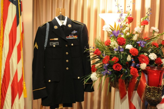 A complete Army Service Uniform with corporal chevrons and a Purple Heart, is displayed next to Cpl. Elmer Kidd's casket during his funeral in Seneca Falls, N.Y. Kidd served with the 32nd Infantry Regiment in the Chosin Reservoir, during the Korean War, and his remains recently returned home after being found.