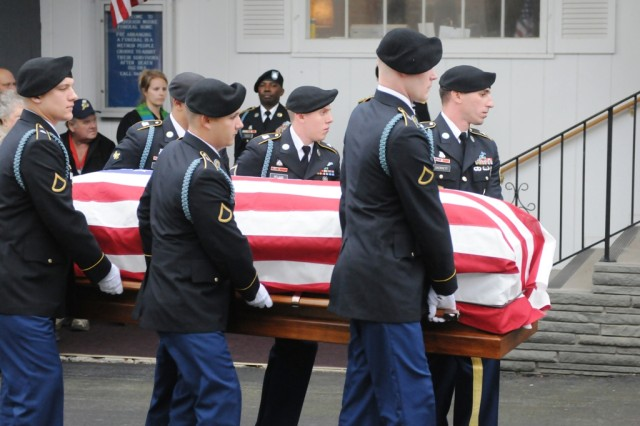 Soldiers with 2nd Battalion, 87th Infantry Regiment, 3rd Brigade Combat Team, 10th Mountain Division, carry Cpl. Elmer Kidd's casket to an awaiting hearse, during his funeral ceremony, Nov. 9, 2012, in Seneca Falls, N.Y. Kidd served with the 32nd Infantry Regiment in the Chosin Reservoir in the Korean War, and his remains were recently returned home.