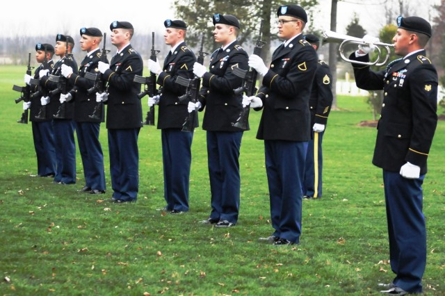 "A firing detail and a bugler from the 2nd Battalion, 87th Infantry Regiment, 3rd Brigade Combat Team, 10th Mountain Division, stand at attention while ""Taps"" is played at Cpl. Elmer Kidd's funeral. Kidd was a Korean War Soldier who received full military honors after serving with and dying while with the 32nd Infantry Regiment in the Chosin Reservoir, Korea."