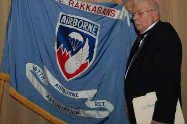 Irving Weinsoff, the President of the National Rakkasan Association, proudly displays the Regimental Colors for the 187th Infantry Regiment, assigned to the 3rd Brigade Combat Team, 101st Airborne Division, 19 Oct. at the 31st Annual National Rakkasan Reunion in Orlando, Fla. The association keeps the unit's historic legacy alive by reuniting its veterans and inviting younger generations of Soldiers to join and share their stories of service as a Rakkasan. (U.S. Army photo taken by Staff Sgt. David C. Reiley, 3rd Brigade Combat Team, 101st Airborne Division)