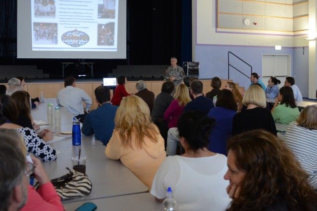 Col. James E. Saenz, U.S. Army Garrison Grafenwoehr commander, discuss concerns with more than 50 educators during a teacher's town hall, Nov. 13.