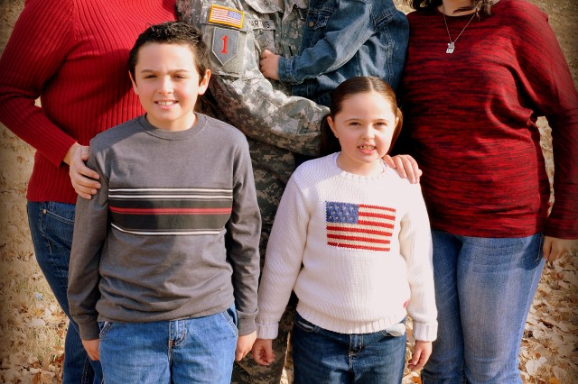 BRO Hero contest co-winner Lt. Allan Hartung, 2nd Armored Brigade Combat Team, center, poses for a photo with his Family Nov. 18 at McCormick Park on Fort Riley. Pictured from left are Amy, Colby, 8, Cwynn, 3, Calleya, 6, and Caitlyn, 15.