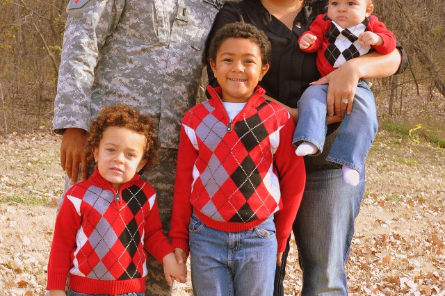 BRO Hero contest co-winner Lt. Treone Frink, 2nd Armored Brigade Combat Team, poses for a photo with his Family Nov. 18 at McCormick Park on Fort Riley. Pictured from left are Aaron, 3, Jordan, 5, Krystal, and Joseph, 6 months.