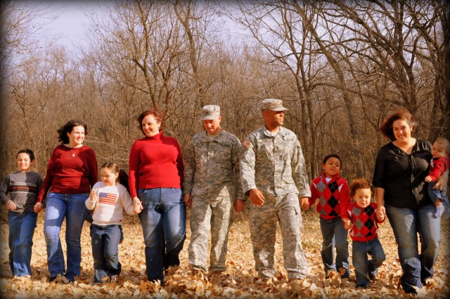 BRO Hero contest winners Lt. Allan Hartung and Lt. Treone Frink, center, gather with their Families at McCormick Park on Fort Riley Nov. 18. Hartung and Frink both belong to the 1st Infantry Division's 2nd Armored Brigade Combat Team
