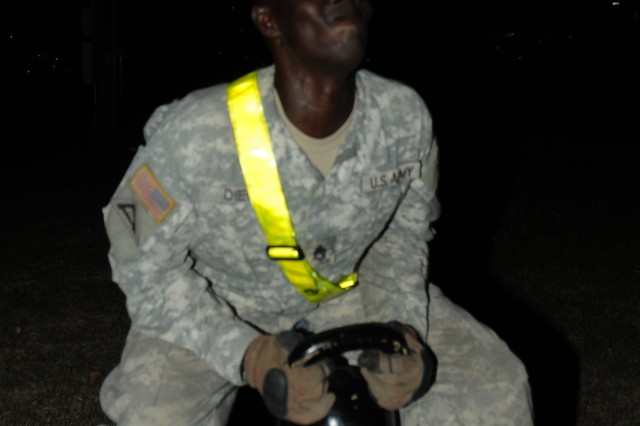 """FORT HOOD, Texas -- Staff Sgt. John Dieu, a senior scout with Troop C., 4-9 Cav. """"Dark Horse,"""" 2nd BCT, 1st Cav. Div., performs a goblet squat during the 3.2-mile, round robin Dark Horse Noncommissioned Officer Physical Fitness Challenge here, Nov. 2."""