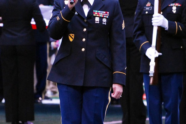 ARLINGTON, Texas -- Sgt. Lindsay Robertson, a Soldier assigned to the 4th Brigade Combat Team, 1st Cavalry Division, sings the national anthem as part of Military Appreciation Day during the opening ceremony of the National Football League game played at the Cowboys Stadium, here, Nov. 18. The game was played between the Dallas Cowboys and the Cleveland Browns. The half-time show featured Soldiers, Sailors, Airmen and Marines, who marched on the field and presented their respective services' flag. Dallas won with a final score of 23-20.