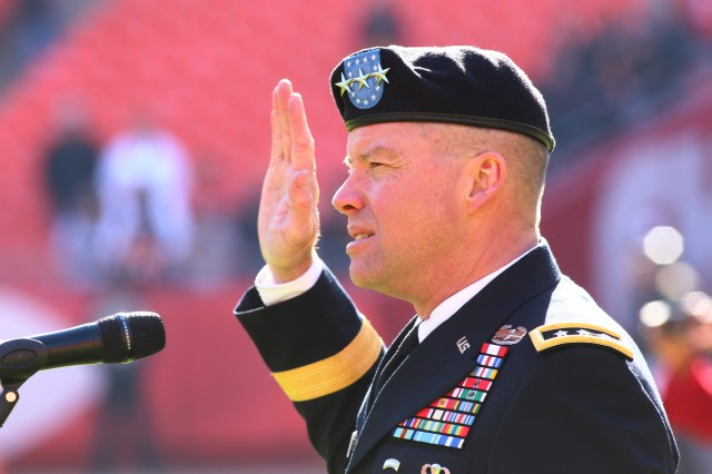 Lieutenant General David G. Perkins officiated the re-enlistment ceremony for 50 Soldiers before the Kansas City Chiefs game, Nov. 18, 2012, at Arrowhead Stadium in Kansas City, Mo.  The game was identified as a military appreciation game to honor the service and dedication of those who have served, or are currently in service in the Armed Forces.
