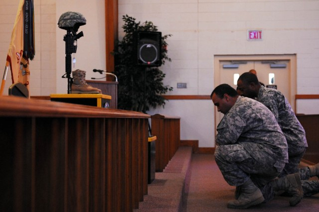 FORT HOOD, Texas-- Soldiers assigned to B Co. of the Muleskinner Battalion, pay their respect to their fallen comrade, Spc. Timothy Singletary, a recovery vehicle mechanic, during his memorial ceremony, here, Nov. 14.