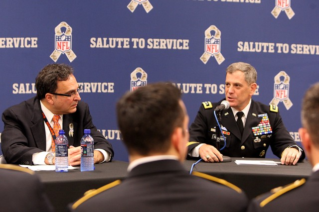 Ted Philips, left, CEO and president of the Chicago Bears, and Lt. Gen. Michael Ferriter, Installation Management Commander, take part in a Nov. 11 forum in Chicago discussing prevention and awareness of Traumatic Brain Injury amongst U.S. service members and NFL players. (Photo by Sgt. 1st Class Anthony L. Taylor, 85th Support Command Public Affairs)