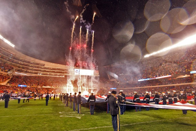 One hundred service members representing the five U.S. Armed Forces hold the American flag during the national anthem at the Chicago Bears Veterans Day game at Soldier Field in Chicago, Nov 11. (Photo by Sgt. 1st Class Anthony L. Taylor, 85th Support Command Public Affairs)
