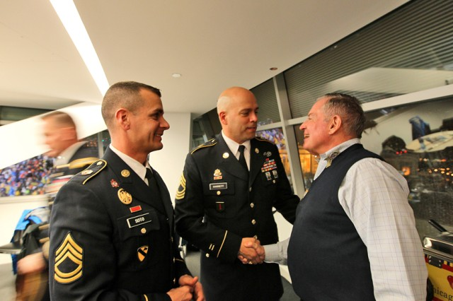 Sgt. 1st Class Ruben Soto, left, and Master Sgt. Gilbert Garrett, center, members of the 85th Support Command, meet with Retired Maj. Gen. John Scully, Civilian Aide to the Secretary of the Army for the State of Illinois, during the Chicago Bears Veterans Day game at Soldier Field in downtown Chicago, Nov. 11. The 85th Support Command was one of several Army units to support recognizing and honoring the nation's veterans in the Chicago-land community. (Photo by Sgt. 1st Class Anthony L. Taylor, 85th Support Command Public Affairs)