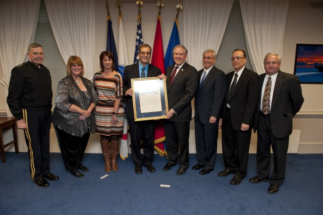 From left: Lt. Gen. William N. Phillips, Principal Military Deputy to the ASA(ALT); Donna Ponce, Procurement Contracting Officer, Army Contracting Command - Rock Island; Maryellen Lukac, Director Business Management, PM Combat Ammunition Systems; Rene Kiebler, Deputy Project Manager, PM Combat Ammunition Systems; Honorable Frank Kendall, Under Secretary of Defense; Martin Moratz, Conventional Ammunition Division, PM Combat Ammunition Systems; Aaron Rappaport, Acquisition Manager, PM Combat Ammunition Systems; Ronald Rapka, retired Acquisition Manager, PM Combat Ammunition Systems