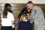 Daughters present fathers with gift basket on Veterans Day