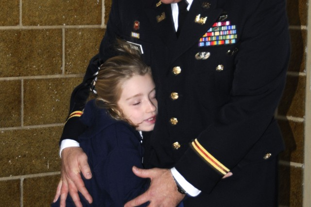 Acting Baltimore District Commander Lt. Col. Brad Endres shares an embrace from his daughter after he presented at St. Louis School in honor of Veterans Day to share his experiences about deployment and helping to rebuild Afghanistan.