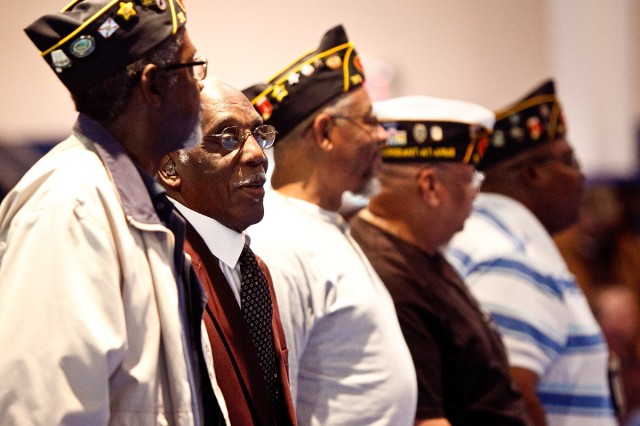 A number of community Veterans groups were present for Anniston Army Depot's Veterans Day ceremony. Here, the Veterans rise for the playing of the Army Song. Music for each of the five military branches was played at the event.