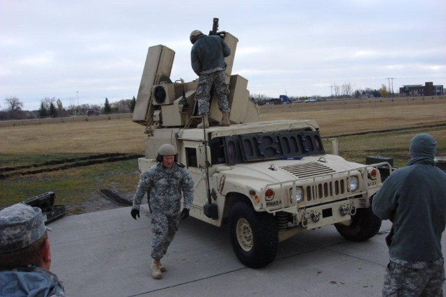 Soldiers of the North Dakota Army National Guard's 1st Battalion, 188th Air Defense Artillery Regiment conduct missile reload procedures as part of their initial assessment by the 5th Armored Brigade's Task Force Renegade in Grand Forks, N.D. Task Force Renegade is training the Guard Soldiers to help protect the National Capital Region in support of Operation Noble Eagle. (Photo by Master Sgt. Randall Roland, 1st Battalion, 362nd Air Defense Artillery, 5th Armored Brigade, Division West)