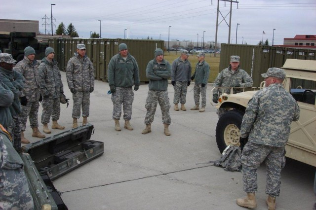 Soldiers of the North Dakota Army National Guard's 1st Battalion, 188th Air Defense Artillery Regiment receive instructions on missile reload from their master gunners during an initial assessment by the 5th Armored Brigade's Task Force Renegade Battalion in Grand Forks, N.D. Task Force Renegade is training the Guard Soldiers to help protect the National Capital Region in support of Operation Noble Eagle. (Photo by Master Sgt. Randall Roland, 1st Battalion, 362nd Air Defense Artillery, 5th Armored Brigade, Division West)