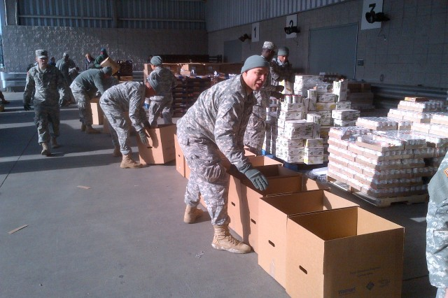 "Soldiers from the New York Army National Guard's 369th Sustainment Brigade, the legendary ""Harlem Hellfighters,"" prepare holiday meals at Manhattan's Jacob Javits Center for shipment and delivery to city distribution sites.  The meals will be distributed to those communities most severely impacted by the landfall of Hurricane Sandy, Oct. 29, 2012.  Nearly 900 National Guard Soldiers and Airmen remain on duty for storm recovery operations to assist local emergency managers."