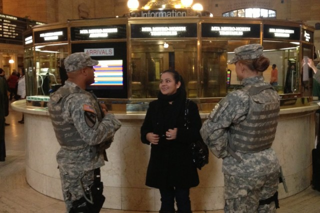 New York Army National Guard Sgt. Windollyn Patino, left, and Spc. Regan Smith conduct a security presence patrol and speak with a traveler here at the Grand Central Terminal rail station in New York City, Nov. 20, 2012.  The Soldiers are part of the New York National Guard's Joint Task Force Empire Shield, the standing security force assisting New York City law enforcement and emergency managers.