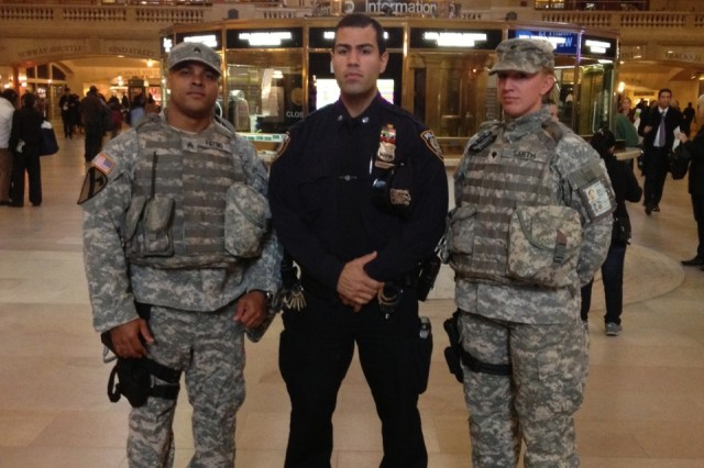 New York Army National Guard Sgt. Windollyn Patino, left, and Spc. Regan Smith conduct a security presence patrol with an NYPD police officer at the Grand Central Terminal rail station in New York City, Nov. 20, 2012.  The Soldiers are part of the New York National Guard's Joint Task Force Empire Shield, the standing security force assisting New York City law enforcement and emergency managers.