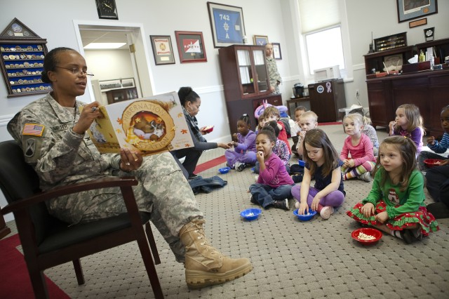 Col. Fern O. Sumpter, Joint Base Myer-Henderson Hall commander, reads to children from the 9B class at the Cody Child Development Center during a visit to her office Nov. 14 (Photo by Rachel Larue).