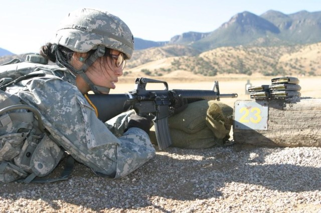 Staff Sgt. Alice Park, 62nd Army Band, zeros in her weapon during the range part of the Best Warrior Competition.