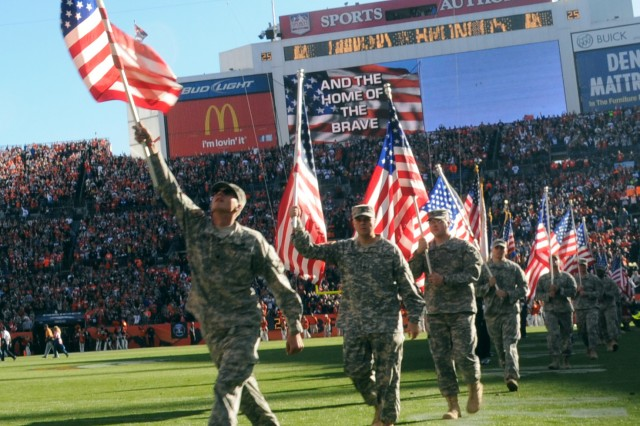 "DENVER "" Soldiers and Family members of the 2nd Brigade Combat Team, 4th Infantry Division, enter Sports Authority Field at Mile High in Denver, Nov. 18, 2012. Fifty Soldiers and 25 spouses received tickets to the Denver Bronco's ""Military Salute to Service"" where the Soldiers participated in pregame and halftime festivities that recognized all the branches of the Armed Forces for their service to the nation."