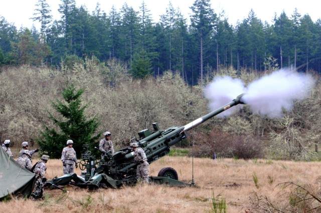 A cannon crew with Battery A, 1st Battalion, 377th Field Artillery Regiment, fires a high-explosive round from an M777A2 howitzer during a live-fire demonstration, Nov. 15, 2012, at Joint Base Lewis-McChord, Wash. The unit, as part of 17th Fires Brigade, invited leaders from its partner community in Tumwater, Wash., to watch the demonstration and meet the Soldiers.