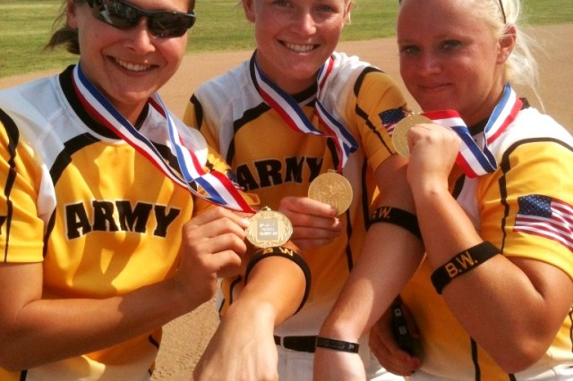 2012 All-Army Women's Softball teammates, 1st Lt. Alyson McWherter, Sgt. Ashley Walker, and Staff Sgt. Nicole Dunn, gather together just after securing the tournament championship to display their gold medals and arm bands with Sgt. Brian Walker's initials embroidered on them Sept. 20. The team wore the arm bands during all of their games this year as a way to remember and honor Sgt. Brian Walker who was tragically killed during combat operations in Afghanistan May 13. (Courtesy photo)