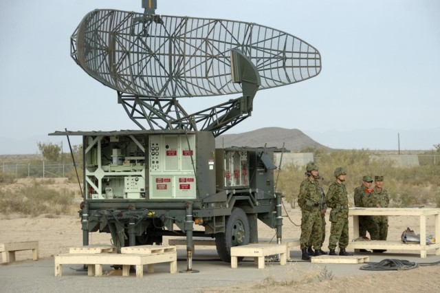Japan Ground Self-Defense Force soldiers await further instructions by a pulse acquisition radar, Nov. 17, 2012, during the Chu-Sam and Hawk missile annual service practice at McGregor Range Complex, N.M. The pulse acquisition radar detects low and medium altitude threats for the Hawk system.