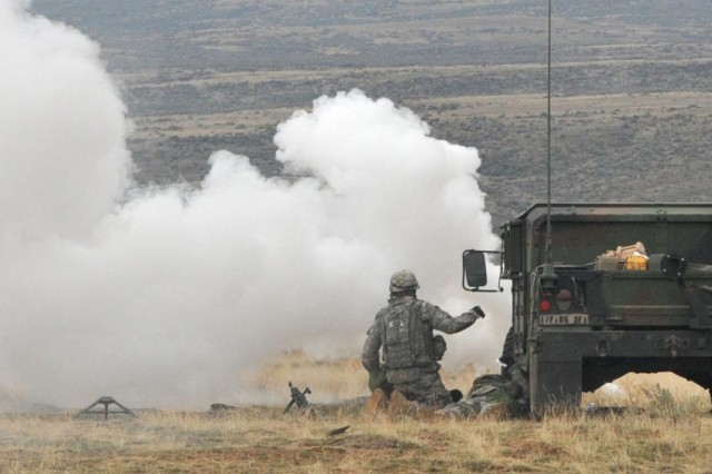 Soldiers defend the tactical operations center of 5th Battalion, 3rd Field Artillery Regiment, Nov. 11,2012, during a simulated attack. The Soldiers were taking part in a training exercise at Yakima Training Center, Wash.