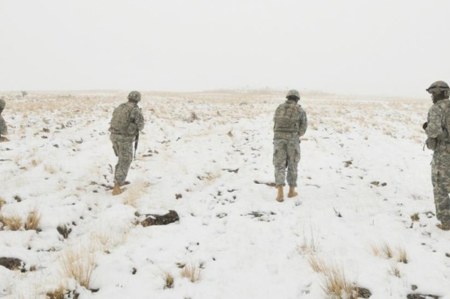 Soldiers with 657th Forward Support Company advance on paper targets as part of dismounted operations during a convoy exercise at Yakima Training Center, Wash., Nov. 12, 2012.