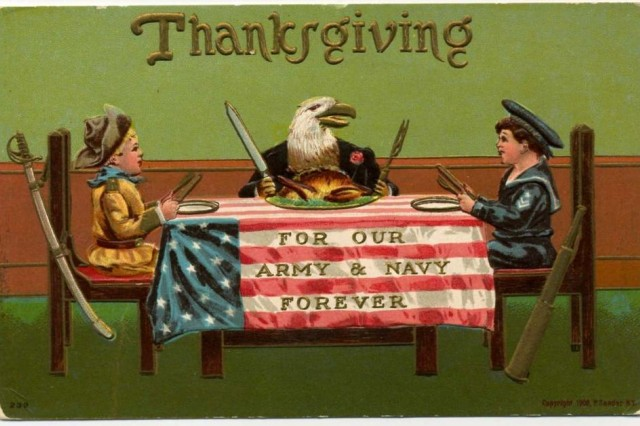 In this postcard from 1908, children dressed in Army and Navy uniforms sit at a flag-draped table along with a bald eagle.