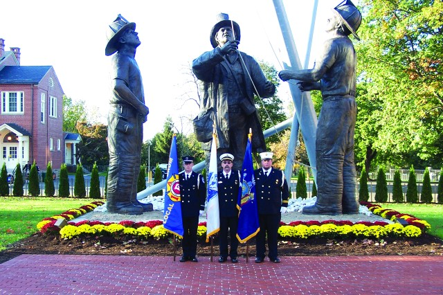 Kip Bachar, center, Aircraft Rescue and Firefighting Company lead firefighter at Fort Drum's Fire Station 3, stands with fellow firefighters in front of the 9/11 Memorial on the National Fire Academy campus in Emmitsburg, Md., last year during the Garrett W. Loomis dedication at the National Fallen Firefighters Memorial. Loomis was a Fort Drum firefighter who lost his life while battling a silo fire at a dairy farm in Hounsfield on April 11, 2010. Lt. Aaron Sherman, left, Fort Drum firefighter, and Mike Van Ness, Sackets Harbor Volunteer Fire Department firefighter, joined Bachar and a handful of others in providing the Loomis family with a color guard.