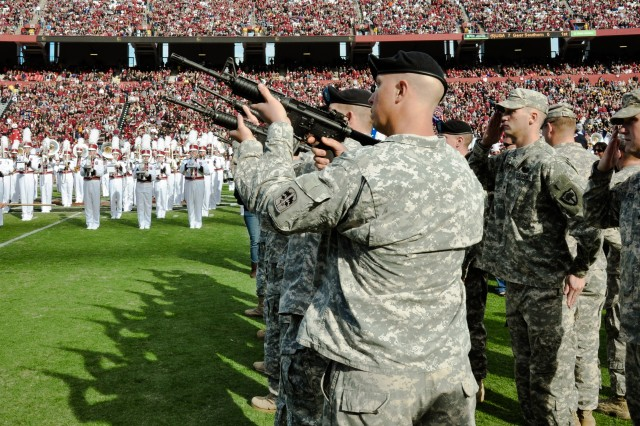 The salute battery from the 171st Infantry Battalion participates in halftime activities during Saturday's game.