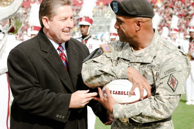 Ray Tanner, athletic director with the University of South Carolina, and Brig. Gen. Bryan Roberts, Fort Jackson's commanding general, share a light moment before Saturday's military appreciation game against Wofford. Soldiers from various units on Fort Jackson attended the game and participated in the pregame and halftime ceremonies. Roberts served as the honorary captain and tossed the coin before the game. USC won, 24-7.