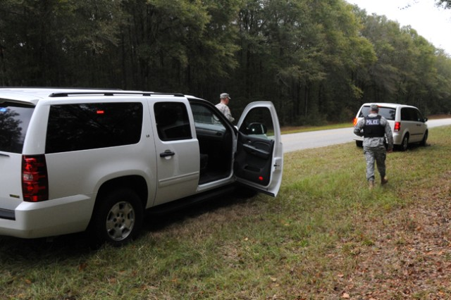 Maj. Joshua Munch, deputy provost marshal, and Staff Sgt. Jacob Deaton, traffic investigations NCO in charge, make a routine traffic stop Nov. 15. after a vehicle failed to obey a visual traffic device.